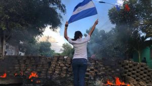 2018_Nicaraguan_protests_-_woman_and_flag-1024x576